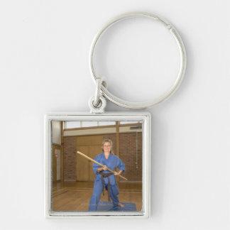 Woman performing Ken-Do-Kai Karate, smiling, Silver-Colored Square Key Ring