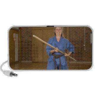 Woman performing Ken-Do-Kai Karate smiling iPhone Speakers