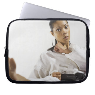 Woman performing martial arts 2 laptop sleeve