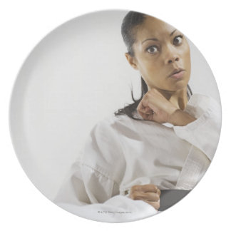 Woman performing martial arts 2 plate