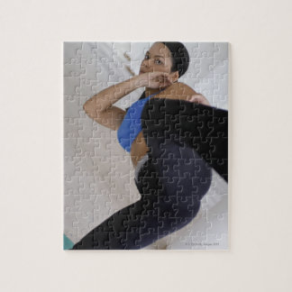 Woman performing martial arts jigsaw puzzle