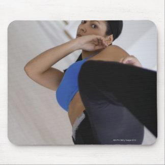 Woman performing martial arts mouse mat
