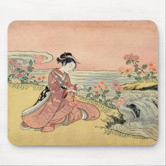 Woman picking chrysanthemums mouse mat
