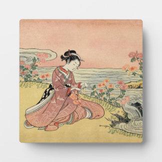 Woman picking chrysanthemums plaque