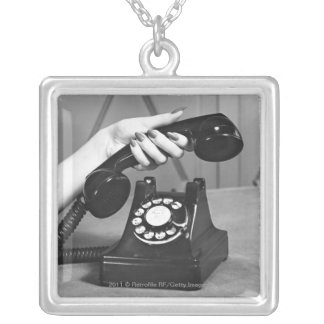 Woman picking up phone close up of hand silver plated necklace