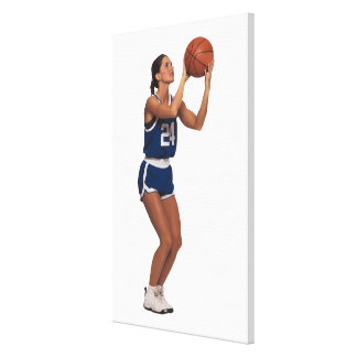 Woman player shooting basketball canvas print