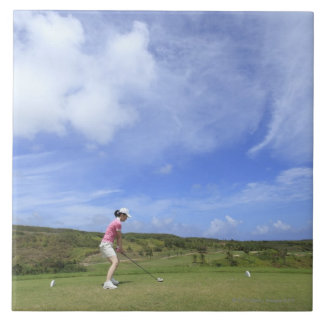 Woman playing golf tile