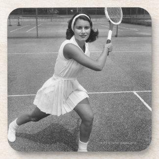 Woman playing tennis coaster