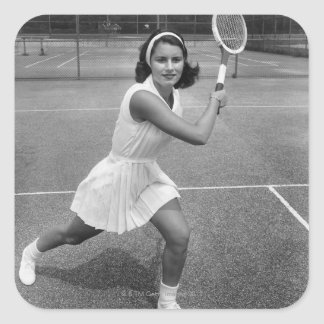 Woman playing tennis square sticker