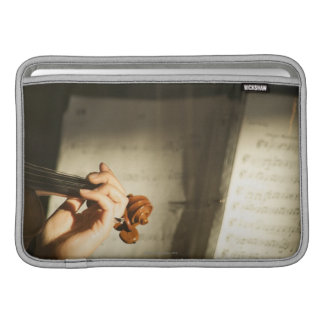 Woman Playing Violin MacBook Sleeve