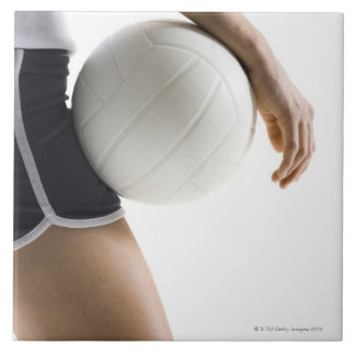 woman playing volleyball large square tile