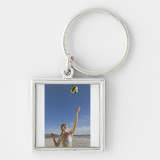 Woman playing volleyball on beach Silver-Colored square key ring