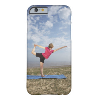 Woman practicing yoga by the beach barely there iPhone 6 case