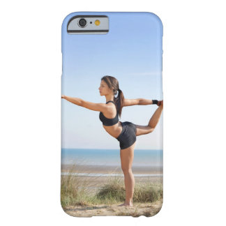 Woman practicing yoga on beach barely there iPhone 6 case