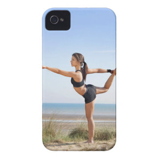 Woman practicing yoga on beach iPhone 4 case