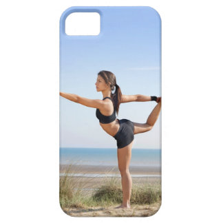 Woman practicing yoga on beach iPhone 5 cover