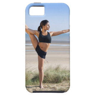 woman practicing yoga on beach wearing iPhone 5 case