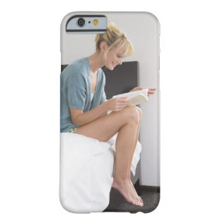 Woman reading a book on the bed barely there iPhone 6 case