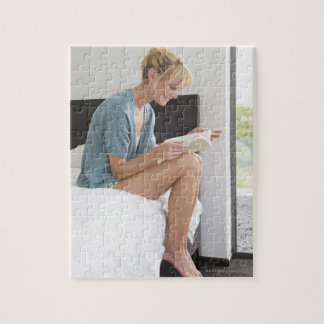 Woman reading a book on the bed puzzles