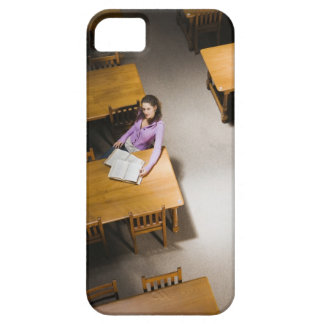Woman reading book in library case for the iPhone 5