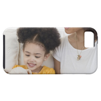 Woman reading book with daughter iPhone 5 cover