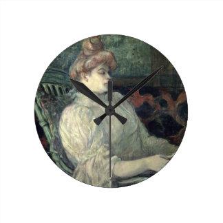 Woman Reading Round Clock