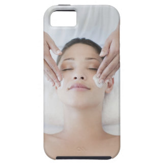 Woman receiving facial massage iPhone 5 cases