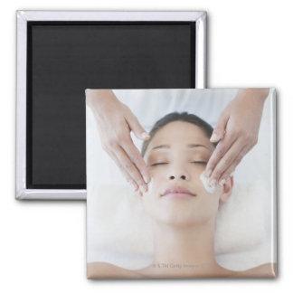 Woman receiving facial massage magnet