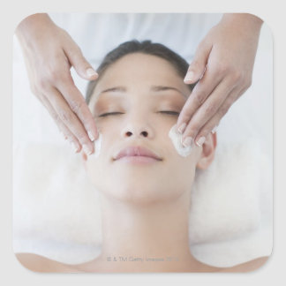 Woman receiving facial massage square sticker