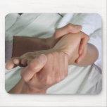 Woman receiving foot massage 2 mouse mat