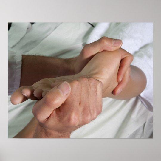 Woman receiving foot massage 2 poster