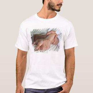 Woman receiving foot massage 2 T-Shirt