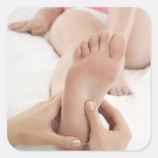 Woman Receiving Foot Massage Square Sticker