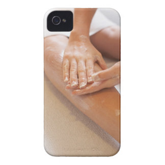Woman receiving leg massage with lotion iPhone 4 cases