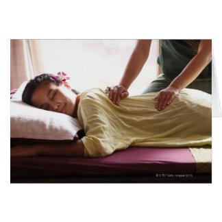 Woman receiving massage #1 greeting card