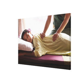 Woman receiving massage #1 stretched canvas prints