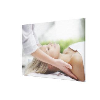 Woman receiving massage canvas print