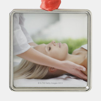 Woman receiving massage christmas ornament