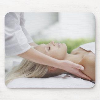 Woman receiving massage mouse mat