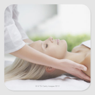 Woman receiving massage square sticker