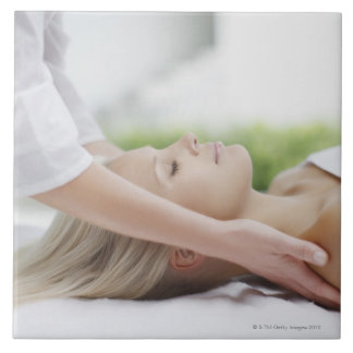 Woman receiving massage tile