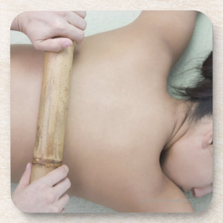 Woman receiving spa treatment coaster
