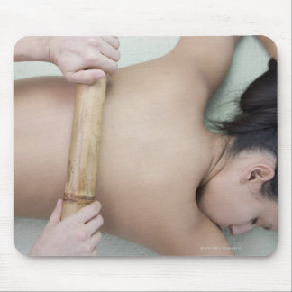 Woman receiving spa treatment mouse pad