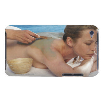 Woman receiving spa treatment, side view, close barely there iPod covers