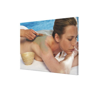 Woman receiving spa treatment, side view, close canvas print