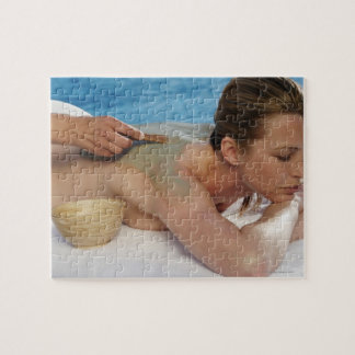 Woman receiving spa treatment, side view, close jigsaw puzzle