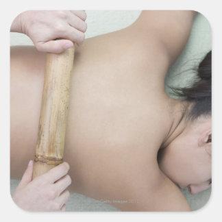 Woman receiving spa treatment square sticker