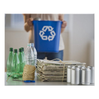 Woman recycling plastic bottles, cans and poster