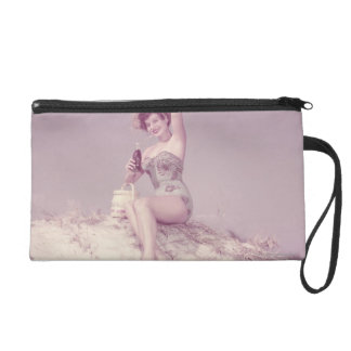 Woman Relaxing on Beach Wristlet Clutches