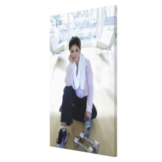 Woman resting on the floor after exercising. canvas print